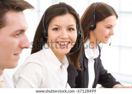 Face of beautiful businesswoman on the background of business people - stock photo