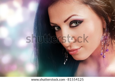 Face of beautiful sexy woman with colorful make-up - stock photo