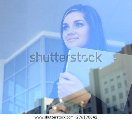 Face of beautiful woman on the background of business people - double exposure - stock photo