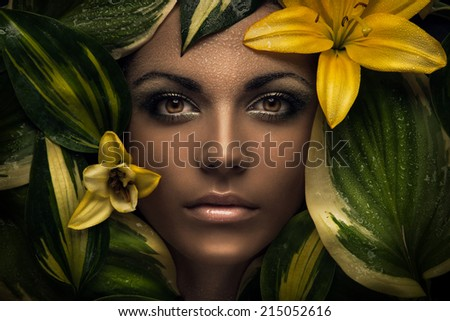 Face of beautiful woman with flowers around the face. Fashion photo, beauty portrait, beauty model - stock photo
