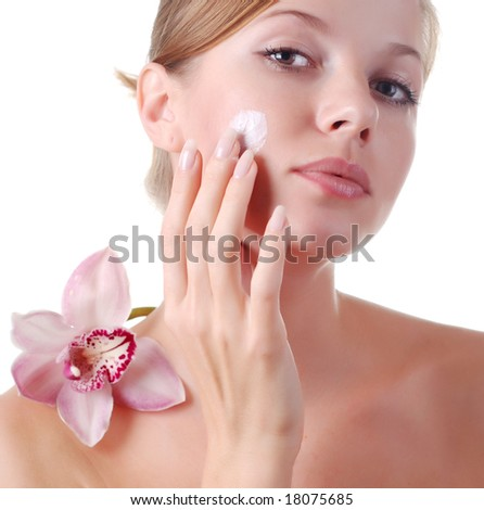 face of beautiful young woman with delicate orchid - stock photo