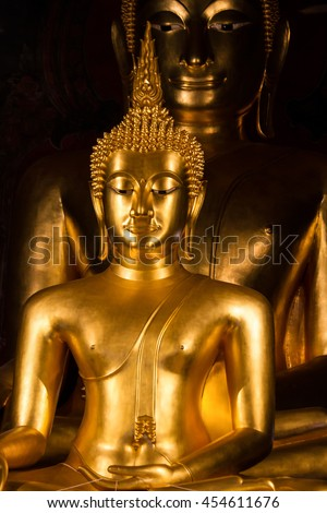 Face of Buddha statue isolated on black  shadow background - stock photo