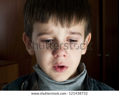 Face of crying little boy - stock photo