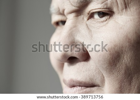 Face of elderly man looking at camera. Horizontal photo - stock photo