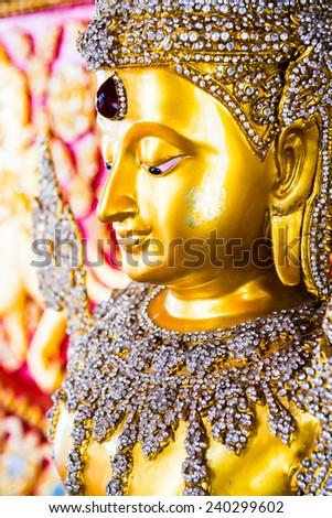 Face of golden buddha statue, Thailand - stock photo