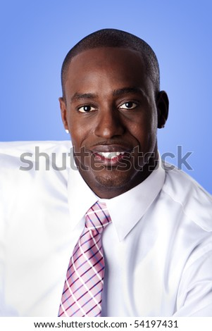 Face of handsome happy African American corporate business man smiling, wearing white shirt and pink with stripes necktie on a blue sky-like background. - stock photo