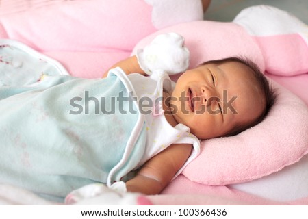 face of infant on baby bed - stock photo