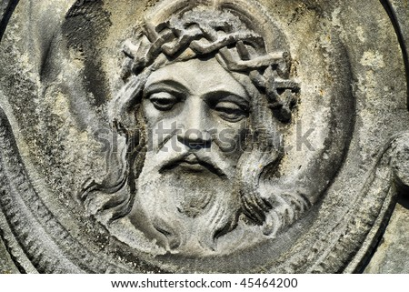 face of Jesus, old statue in cemetery - stock photo