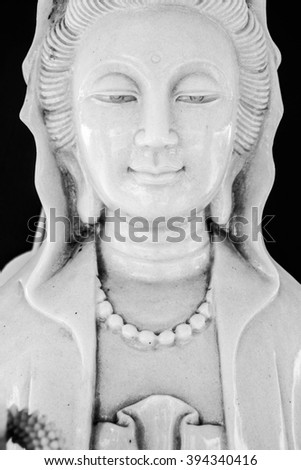 Face of Kuan Yin white marble.