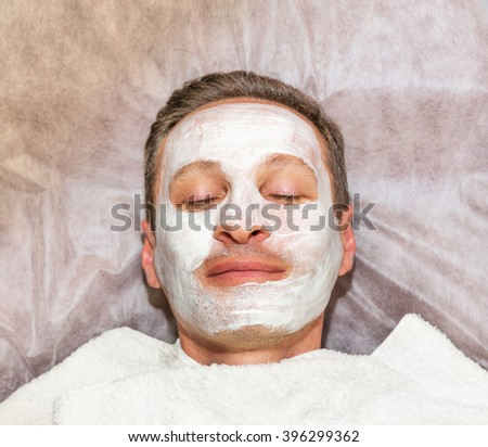 Face of laying man with cream mask, beauty, spa - stock photo