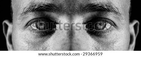 face of male and eyes. man staring and focus on camera
