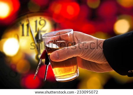 face of new year clock with a alcohol glass - stock photo
