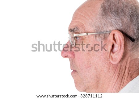 Face of old man in golden glasses closeup. Side view. Isolated on a white background. - stock photo