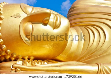 Face of Reclining buddha at thailand. Generality in Thailand, This photo is public domain or treasure of Buddhism, no restrict in copy or use. No any trademark or restrict matter in this photo. - stock photo