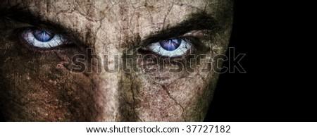 Face of scary creepy spooky man with evil eyes - stock photo