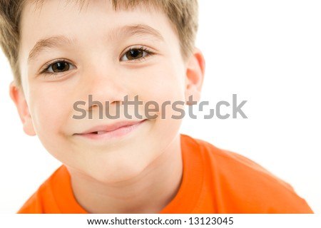 Face of smiling boy with brown eyes on a white background - stock photo