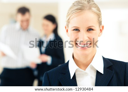 Face of successful business woman looking at camera with smile - stock photo