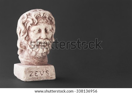Face of the divine Zeus also called God's daytime sky represented on a dark background - stock photo