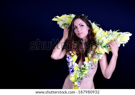 face of the girl in a flower dress - stock photo