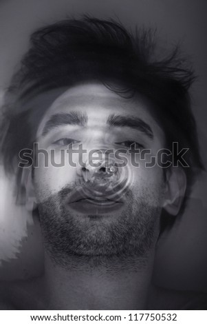 Face of the young men under  water closeup - stock photo