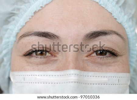 face of woman doctor - stock photo