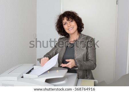 Face of  woman on the next to a copy machine at office  - stock photo