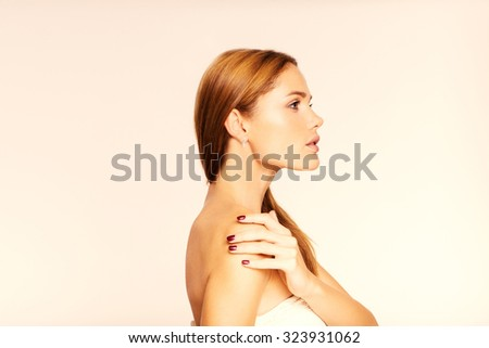 face of young beautiful woman with clean skin. Face in profile. - stock photo