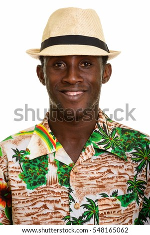 Face of young happy black African man smiling isolated against white background