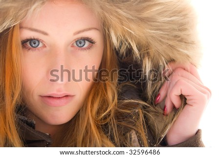 Face of young pretty woman close up - stock photo