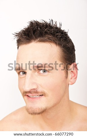 Face of young smiling man, looking on. - stock photo
