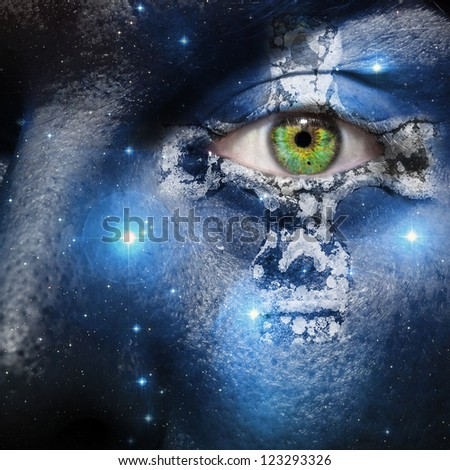 Face overlay of the seven sisters constellation with a Celtic cross centering around the green eye - stock photo