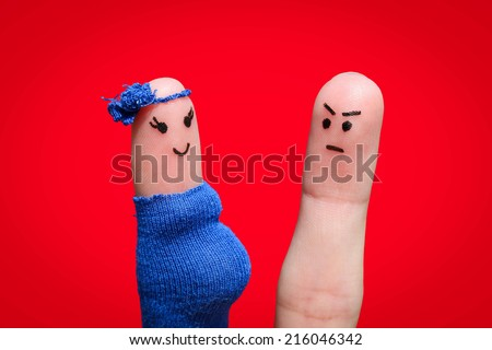 Face painted on fingers. The man was upset because the woman is pregnant - stock photo