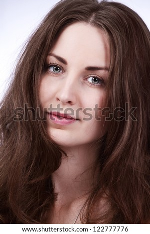 Face portrait of a beautiful girl with long brown hair