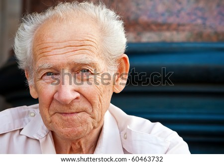 face portrait of a cheerful smiling senior man - stock photo