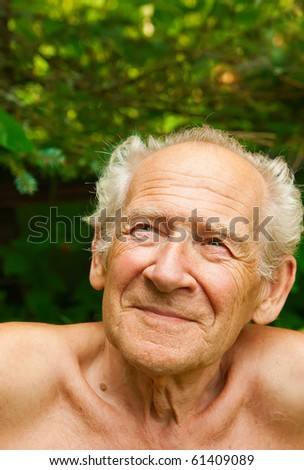 face portrait of a cheerful smiling senior man looking up - stock photo