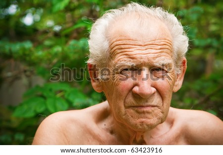 face portrait of an old unhappy frowning senior man - stock photo