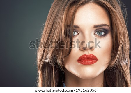 Face portrait of beautiful woman. Long hair. Red lips.