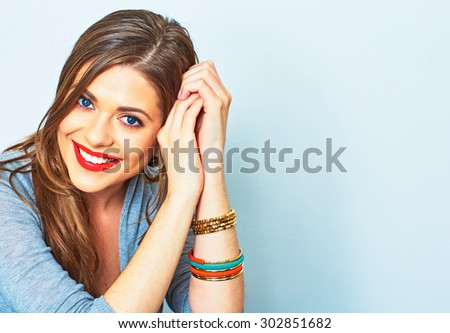 Face portrait of smiling girl. Female model studio portrait. - stock photo