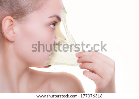 Face profile girl young woman in facial peel off mask before and after procedure. Peeling. Beauty and body skin care concept. Isolated on white background. - stock photo