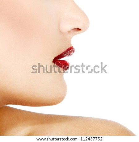 Face profile of young gorgeous fresh woman with vivid red lipstick, face detail. Isolated over white background - stock photo