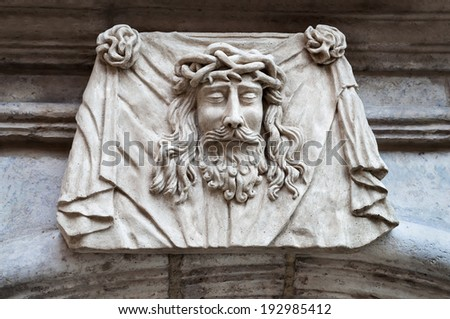 Face sculpture of Jesus ��¡hrist, close-up on 19 century building facade - stock photo