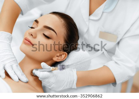 Face Skin Care. Closeup Of Beautiful Woman Getting Diamond Microdermabrasion Peeling Treatment In A Beauty Spa Salon. Cleansing Procedure. Cosmetology.