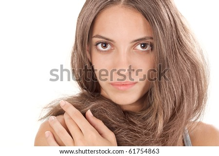 Face studio portrait of young lady with long hairs twisted round like a scarf