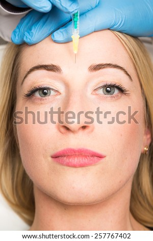 face, wrinkles, syringe - stock photo