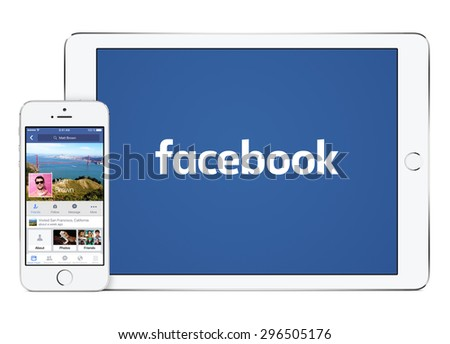 Facebook app on the Apple iPhone 5s in portrait orientation and Facebook new logo on the Apple iPad Air 2 in landscape orientation. Isolated on white background. Varna, Bulgaria - February 02, 2015. - stock photo