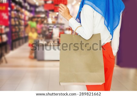 faceless shot of muslim woman on shopping - stock photo