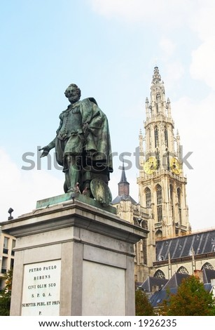 Faces of Antwerp: Rubens statue with cathedral in the background - stock photo