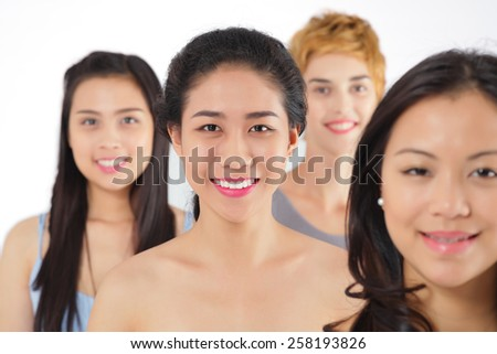 Faces of beautiful smiling girls - stock photo