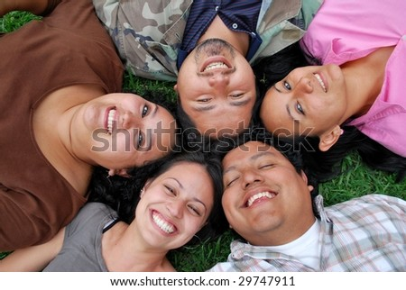 faces of happy Hispanic friends