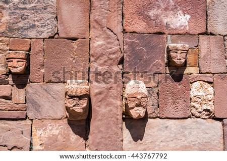 Faces on a wall in the semi-subterranean temple in Tiwanaku near La Paz, Bolivia - stock photo